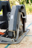Working circular saw. Electric circular saw cuttig OSB sheet Stock Photo