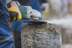 Working circular saw outdoors, sawdust flying around Royalty Free Stock Photos