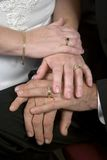 Working Class Wedding Hands. A closeup of the hands of a newly married couple. They are callused, working class hands royalty free stock image