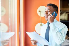 Working with client by phone Royalty Free Stock Image
