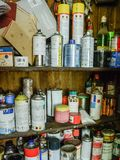 Full working closet of cans. Working closet full of cans, tins and other stuff, which is normal in any working room stock photos