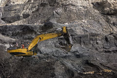 Working the coal seam. 40 ton excavator extracting high grade coal from a seam in Westland, New Zealand stock images