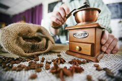 Working with coffee grinder Royalty Free Stock Images