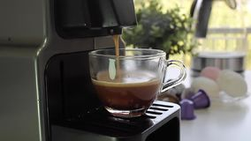Working coffee machine makes strong black coffee, beautiful window view behind stock video footage