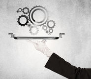 Working cog wheel concept on tray Stock Photography
