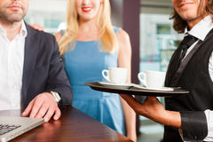 Working colleagues - sitting in cafe Stock Images