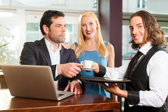 Working colleagues - sitting in cafe Royalty Free Stock Photo