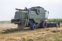 Working combine harvester Royalty Free Stock Photo