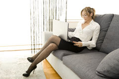 Working with comfort. Woman working on her laptop at home Stock Photography