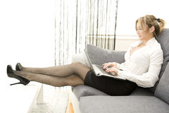 Working with comfort. Woman working on her laptop at home Stock Photo