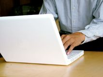 Working on computer. Corporate man working on computer (laptop royalty free stock photo