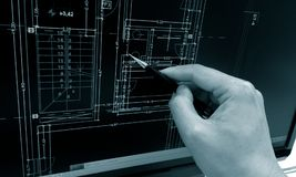Working on computer. Architect working on computer at home layout blueprints detail Stock Images