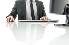 Working on computer Stock Images