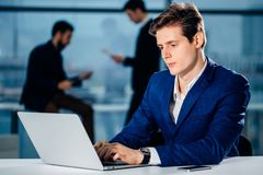 Working on computer laptop online, businessman, person using wifi internet. Business travel, working on computer laptop online, businessman, person using wifi Stock Photography