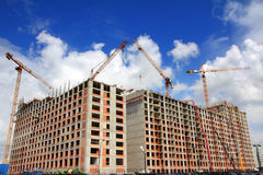 Working construction cranes Stock Images
