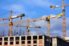 Working construction cranes Stock Photo