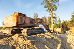 Working construction machinery Stock Images