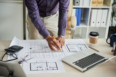 Working on construction plan. Croped image of architect drawing construction plan for building project royalty free stock image