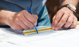 Working on construction plans Stock Image