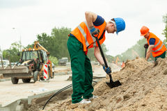 Working at construction site. On city street Royalty Free Stock Images