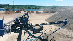 Working conveyor moves crushed stone at a quarry. Mining industry equipment. stock footage