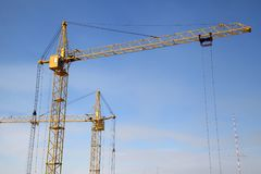 Working crane on the construction of the house. Stock Images