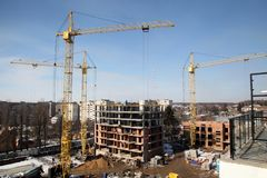 Working crane on the construction of the house. Stock Photos