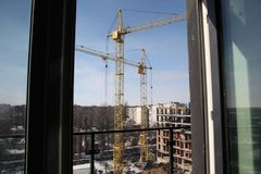 Working crane on the construction of the house. Royalty Free Stock Photo