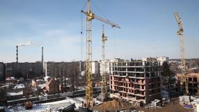 Working crane on the construction of the house. stock footage