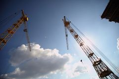 Working crane on the construction of the house. Stock Photo