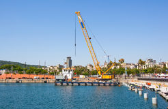 The working crane in Old Harbour, Barcelona, Spain. Stock Photography