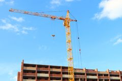 Working crane and red brick residential building Royalty Free Stock Photography