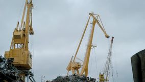 View of cranes on scrap yard.