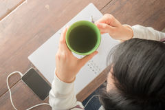 Working creative table and hot green tea drinking Stock Image