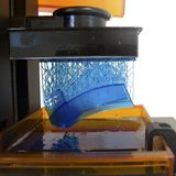 Working 3D printer. Electronic three dimensional printing machine in process royalty free stock photo