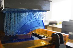 Working 3D printer. Electronic three dimensional printing machine in process royalty free stock photography