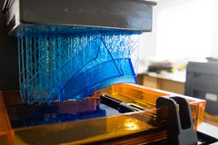 Working 3d printer. 3D printing process. Modern 3D print technology. Working 3d printer machine printing a detail. Close-up royalty free stock photo