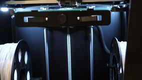 Working 3d printer sequence. Tripod. Printing with Plastic Wire Filament on 3D Printer. Three dimensional printer during stock video