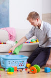 Working daddy cleaning home Royalty Free Stock Photos
