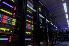 Working data center interior. Concept of hosting, computer cluster, supercomputer, virtual servers, digital cloud or mining crypto currency farm Royalty Free Stock Images