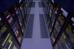 Working data center interior. Concept of hosting, computer cluster, supercomputer, virtual servers, digital cloud or mining crypto currency farm. Top angle Stock Image