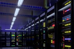 Working data center interior. Concept of hosting, computer cluster, supercomputer, virtual servers, digital cloud or mining crypto currency farm Stock Image