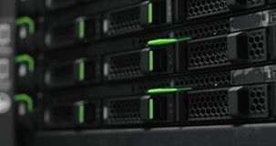 Server rack cluster in a data center. Supercomputer. Network servers in a data center. Working data servers. Server rack cluster in a data center stock video footage