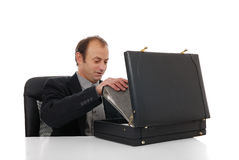 Working day start finish. Businessman pack / unpack documents in order to start / finish his working day Stock Photo