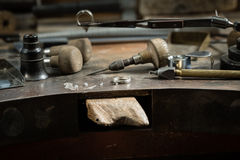 Working desk for craft jewelery making. Craft jewellery making. Measuring of the size of the diamond royalty free stock photography