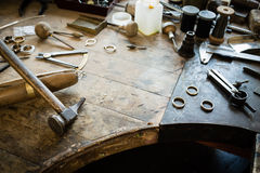 Working desk for craft jewelery making. With professional tools. Grunge wooden table. View from above. Copy space stock photography