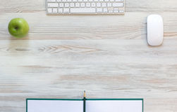Working desk with green apple Royalty Free Stock Image