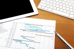 Working desk with project gantt chart Stock Photo