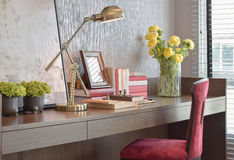 Working desk with reading lamp and red classic chair Royalty Free Stock Images