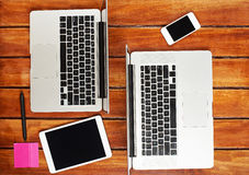 Working desk with two laptops. Smartphonevand tablet stock photos